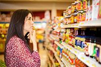 Woman looking at food shelf