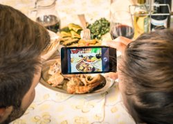 taking a picture of dinner