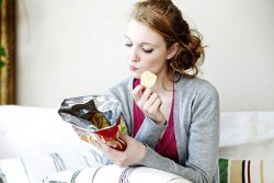 women reading nutrition label